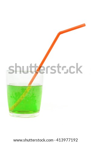 green soft drink glass and red straw, isolated white background