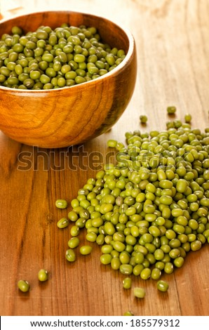Green soybeans on wooden background, biologic agriculture - stock photo