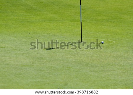 green space and golf ball - stock photo