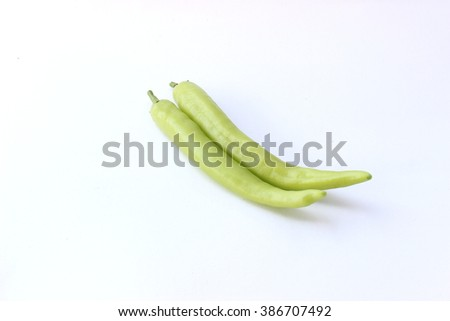 green spicy chili pepper in a white background