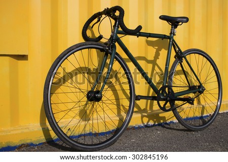 Green sport bike on a yellow background selective focus - stock photo