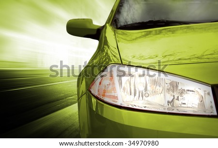 Green Sport Car - Front side - on the road. - stock photo