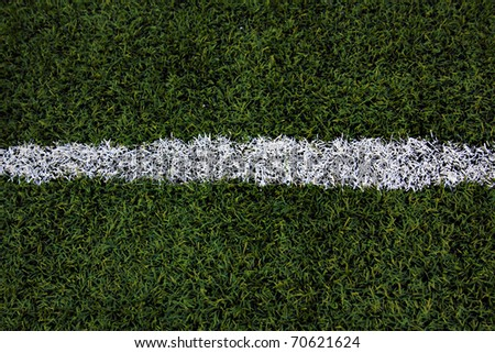 Green sports field with artificial grass - stock photo