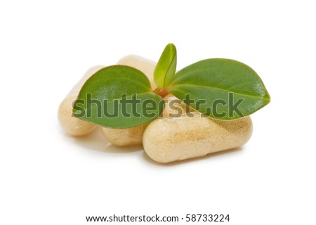 Green sprout from pills isolated on white - stock photo