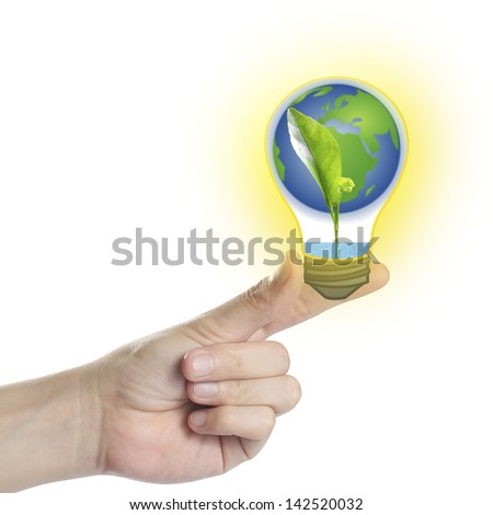 Green sprout growing from seed with water & earth in light bulb on hand