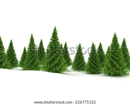Green spruce trees in snow isolated on white