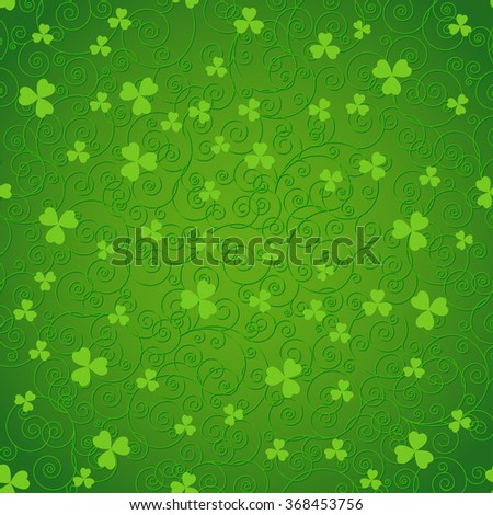 Green St. Patrick's day background with swirls and clover leaves. - stock photo
