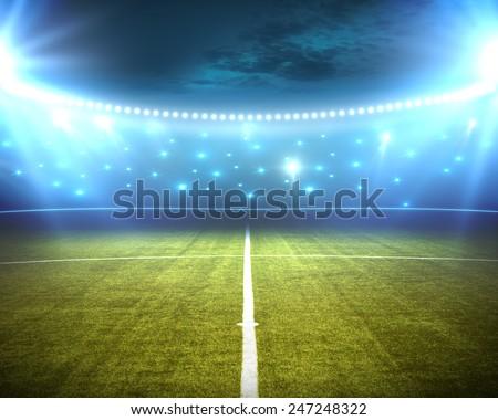 green stadium arena with spotlight - stock photo