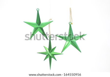 Green stars  christmas decoration for haging on tree isolated on white - stock photo