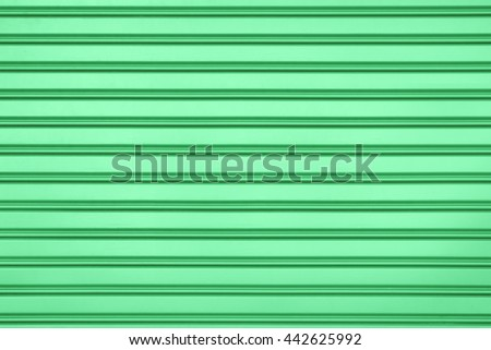 Green steel door with horizontal lines background. - stock photo