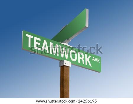 Green street sign reading Teamwork Ave. - stock photo
