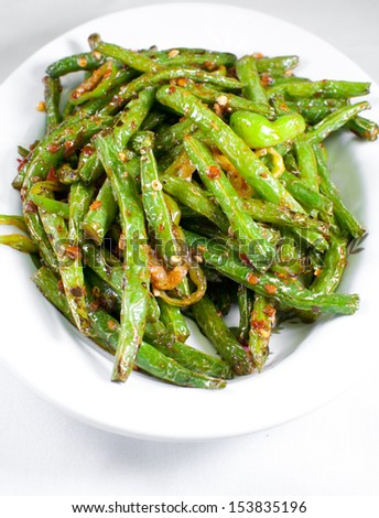 Green string beans chinese dish with spices - stock photo