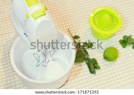 Green stuff - juicer, mixer, lime, mint - stock photo