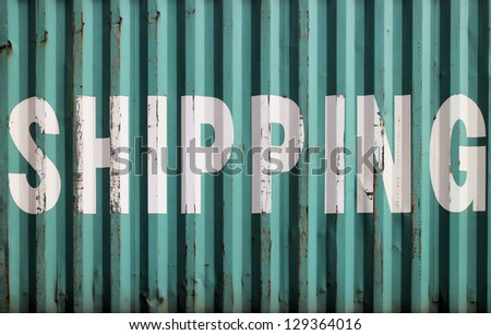 Green surface of a cargo container with shipping sign - stock photo