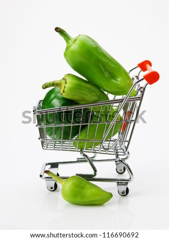 Green sweet pepper paprika  in shopping trolley on white background - stock photo