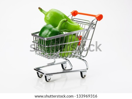 Green sweet pepper paprika  in shopping trolley on white background