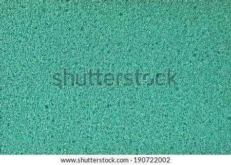 Green synthetic sponge texture background - stock photo