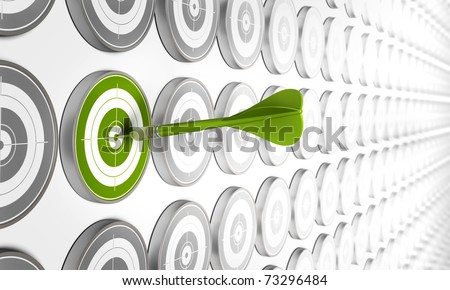 green target hit by a green dart with many other grey targets around - stock photo