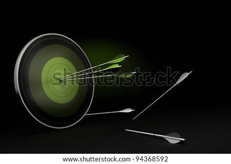 green target onto a black background with three arrows reaching their goal, and whites arrows on the floor failed to reach their objective. - stock photo