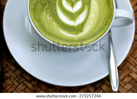 Green tea and milk - vintage - stock photo
