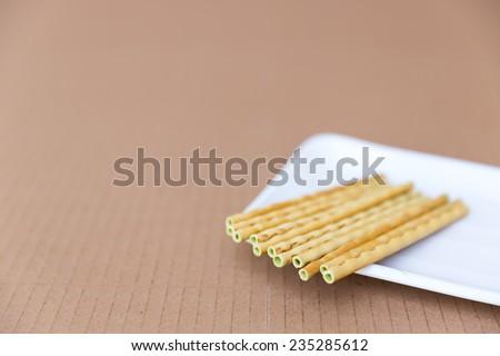green tea biscuit stick, crispy bread straw - stock photo