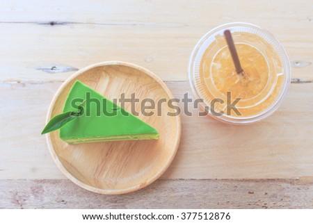 Green tea cake, tea and cake - stock photo