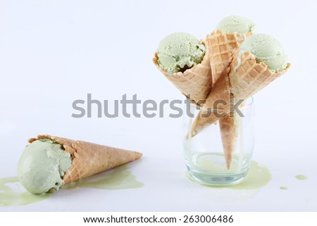 green tea ice cream cones in clear glasses on white background  - stock photo