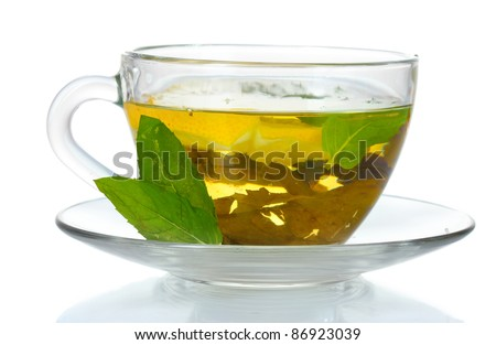 green tea in transparent cup and mint isolated on white - stock photo