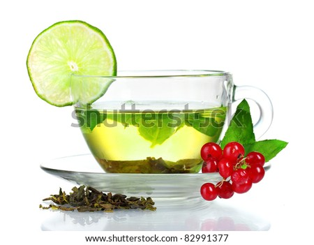 green tea in transparent cup with lime and berry isolated on white - stock photo