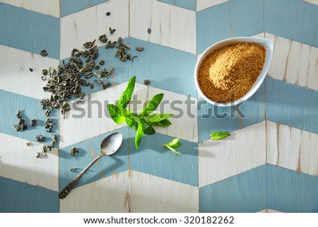 green tea ingredients Moroccan style on wood blue white table - stock photo