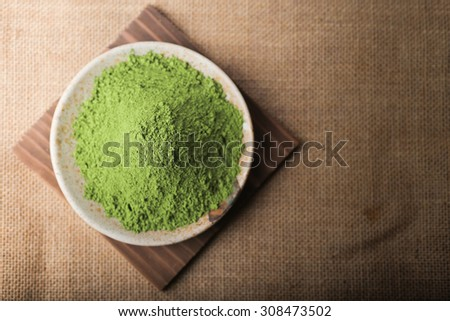 Green Tea powder on the plate, Natural Style. Focus on Green Tea powder. - stock photo