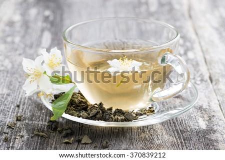 green tea with jasmin, closeup - stock photo