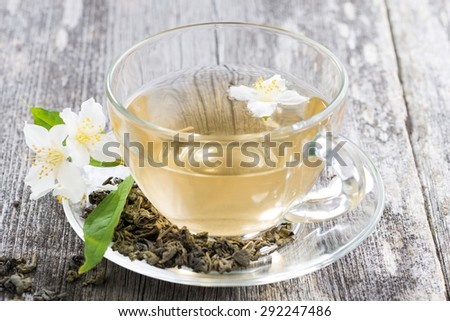 green tea with jasmin in glass cup - stock photo