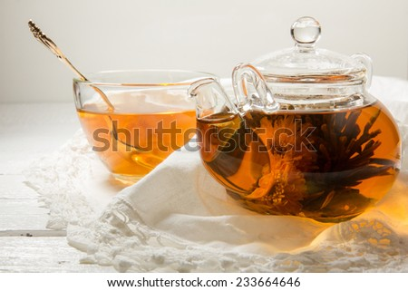 Green tea with jasmine and chrysanthemum in a teapot - stock photo