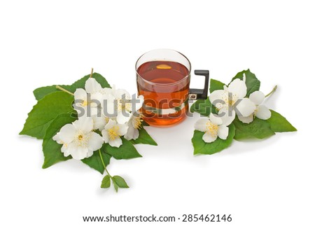 green tea with jasmine flowers isolated on white background - stock photo