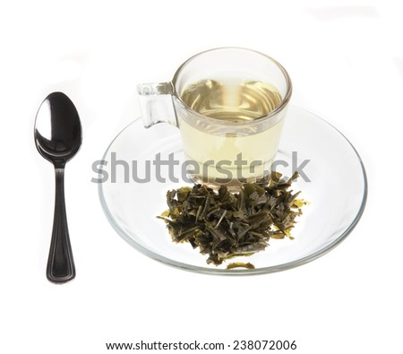 Green tea with leaves fused over the plate