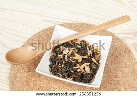 green tea with wooden spoon - stock photo