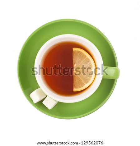 Green teacup with sugar and lemon isolated on white background. - stock photo