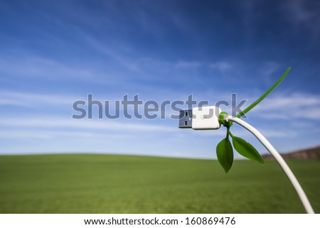 Green technology field and usb cable - stock photo
