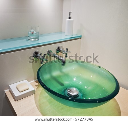 green tempered glass bowl hand wash basin - stock photo