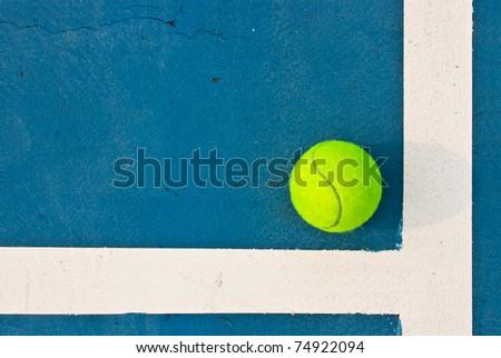 Green tennis ball inside the line - stock photo