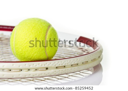 Green tennis ball on the red racket - stock photo