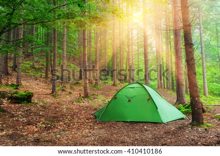 green tent in spring forest  - stock photo