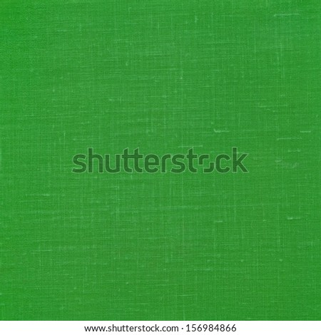 Green textured cloth as background - stock photo