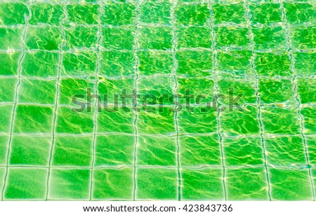 Green tile floor texture background in swimming pool