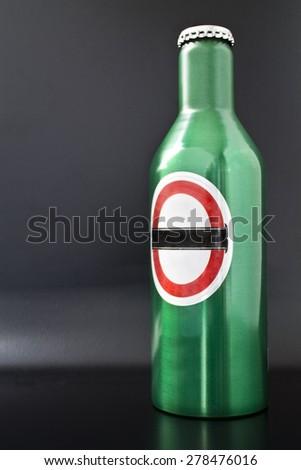 green tin bottle  - stock photo