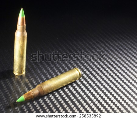 Green tipped ammunition that some consider armor piercing - stock photo