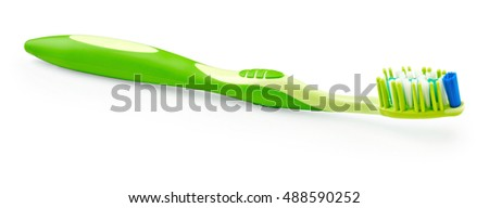 Green toothbrush isolated on white background
