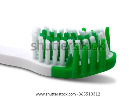 Green toothbrush isolated on white background. Close-up view. - stock photo