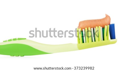 Green Toothbrush With Herbal Toothpaste - stock photo